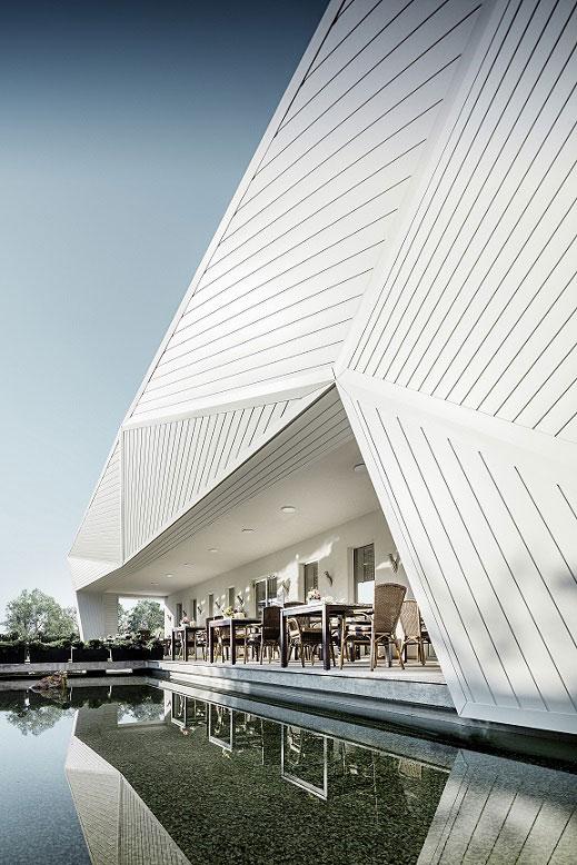 Netradiční plošně prolamovaná fasáda obložená prvky PREFA Siding v bílé barvě.